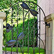 Decorative element of the wrought iron gate with two dragonflies
